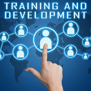 33665099 - training and development concept with hand pressing social icons on blue world map background.